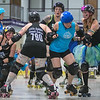 "Jamie ""ShankHERella"" Malecha (far left), Mindy ""Little Debbie Smack Cakes"" Smith (790), Jessica ""Havoc"" Schade (third from right) and Emily ""Derby Puckett"" Brazen (right) of the Black Team try to stop Blue Team jammer Ace ""VelociSlaughter"" Fox from advancing in the MAD Derby Girls last home bout of the year held at All Seasons Arena. Photo by Jackson Forderer"