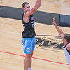 Jake Kettner of Minnesota Valley Lutheran takes a 3-point shot during a scrimmage game at Bethany Lutheran College. Photo by Jackson Forderer