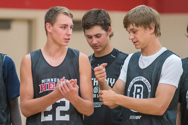 Jake Kettner (left) of Minnesota Valley Lutheran talks with his teammates after a scrimmage game played at Bethany Lutheran College. Photo by Jackson Forderer
