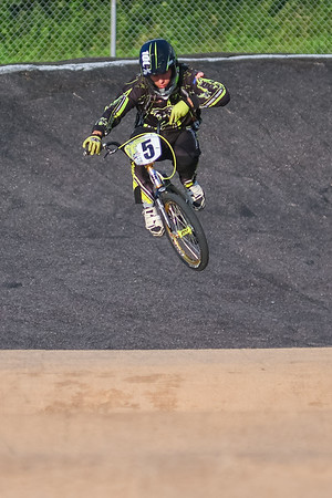 Braeden Ericsson takes a jump off of a mound after making the first turn at the BMX track in Mankato on Wednesday. Ericsson raced in the 17 to 20 year old expert division. Photo by Jackson Forderer
