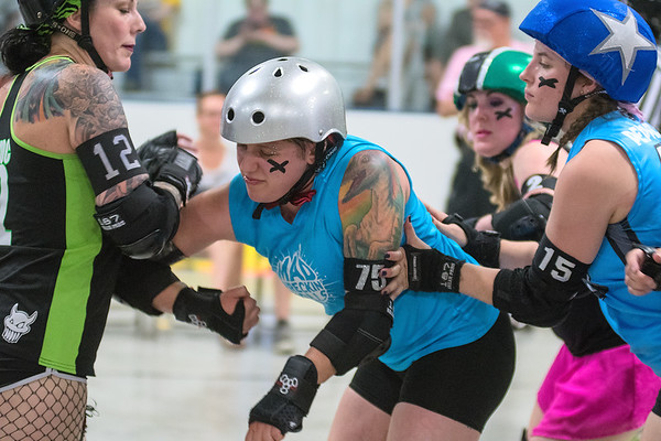 """Ace """"VelociSlaughter"""" Fox (center) tries to help their team's jammer Erica """"Peppers"""" Cora (right) by blocking Photo by Jackson Forderer"""