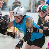 "Ace ""VelociSlaughter"" Fox (center) tries to help their team's jammer Erica ""Peppers"" Cora (right) by blocking Photo by Jackson Forderer"