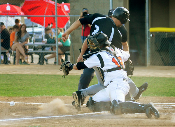 Alexandria's Jeremy Hyde beats a throw to Moondogs catcher Dalton DeLeon to score from first base on a bases-loaded triple for the fourth run  of a five-run inning. Photo by John Cross
