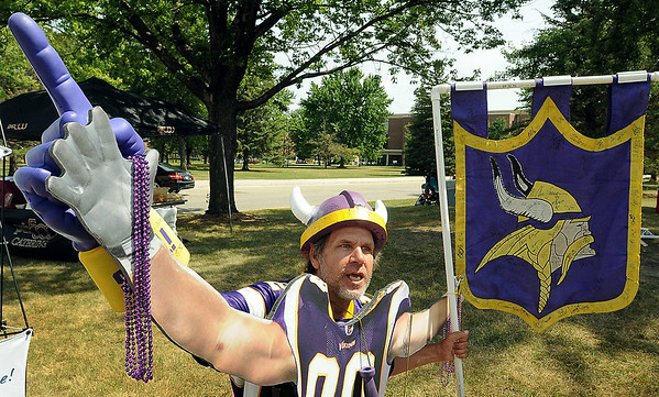Vikings fan Rick Childs of Elysian poses with a cut-out of former Minnesota Viking Jared Allen on Thursday at the tailgate party at Minnesota State University on Thursday.<br /> Photo by John Cross