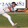 Mankato MoonDogs shortstop Peter Maris lunges for a ground ball during the third inning Tuesday at Franklin Rogers Park. Photo by Pat Christman