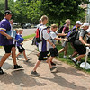 Vikings fans sprint to gain a prime spot after the autograph area was opened in front of the Julia Sears Residence Hall at MSU on Thursday. Photo by John Cross