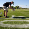 Lucas Grieves, a member of the Vikings' ground crews, paints numbers of one of MSU's practice fields in preparation for the Vikings preseason training camp that opens later this week. John Cross photo