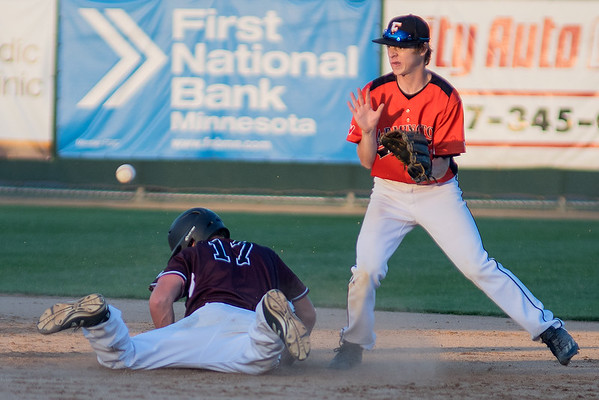 Jack Clifford (17) of the Mankato Royals VFW Post 950 slides into second base before Noah Liebers of Farmington gets the throw. Photo by Jackson Forderer
