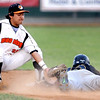 Mankato MoonDogs shortstop Chris Munoz tags out Willmar's Garrett Fischer as he attempts to steal second base during their game Friday at Franklin Rogers Park.