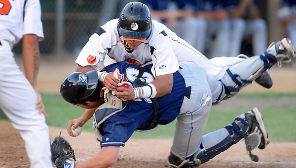 Pat Christman<br /> Mankato MoonDogs' Hibraim Cordova is out at the plate after colliding with Duluth catcher Justin Hazard during the third inning Friday at Franklin Rogers Park.