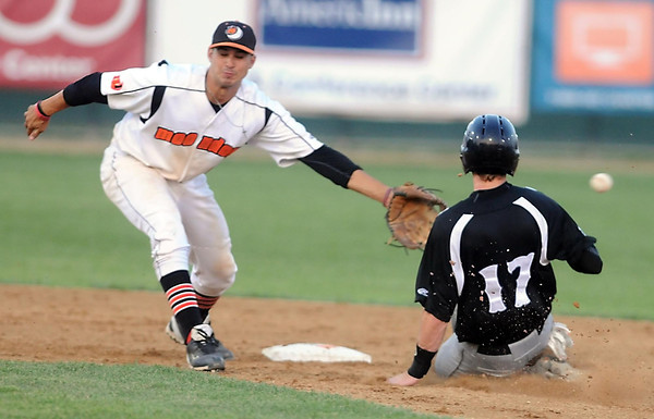 Pat Christman<br /> Mankato MoonDogs shortstop Josh Fuentes can't bring in the throw to second base to catch Alexandria's Keegan Dale stealing during the fifth inning Thursday at Franklin Rogers Park.