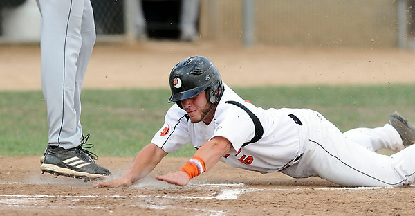 Mankato MoonDogs' Brett Synek scores during a rundown in the third inning of a game against Duluth Friday at Franklin Rogers Park. Photo by Pat Christman
