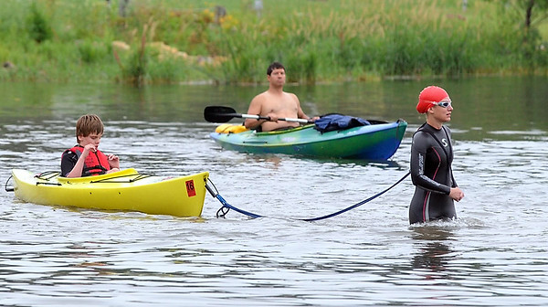 Megan Beer pulls her son Adam, 11, in a kayak during Saturday's Elysian Rookies Triathlon. Beer and her son completed the triathlon together. Photo by Pat Christman