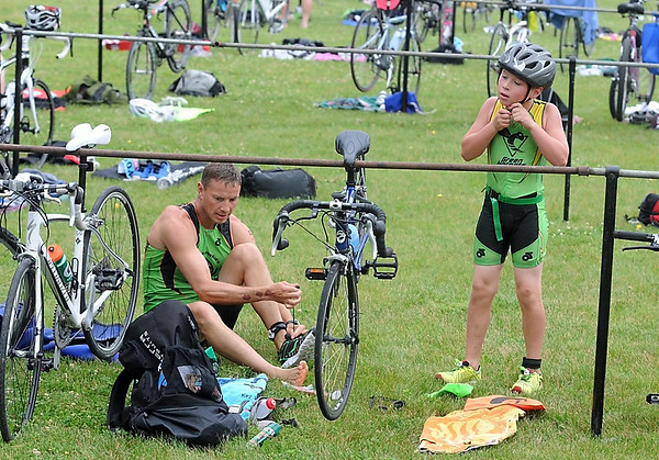 Mike Cahill and his son Jack, 9, get ready for the biking portion of the Elysian Rookies Triathlon Saturday. Photo by Pat Christman