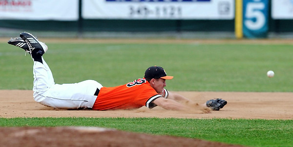 Mankato MoonDogs third baseman Derek Umphres dives for a ground ball but can't get to it during the third inning against Duluth Thursday at Franklin Rogers Park. Photo by Pat Christman