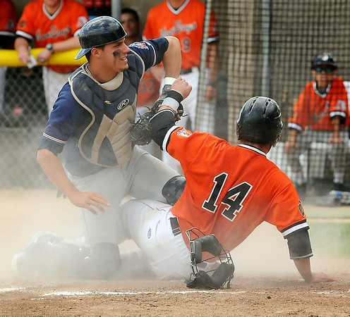 Moondog Ridge Smith is tagged out at home by rox catcher Charles Galiano in a double play to end the fourth inning during action at Franklin Rogers Park on Tuesday. Photo by John Cross