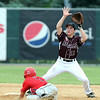 The ball hops over Mankato VFW Maroon's Ethan Gruis as St. James VFW's Brady Stevens slides into second base during the first game of a doubleheader Saturday at Wolverton Field. Photo by Pat Christman