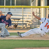 Kenton Crews (14) of the Mankato MoonDogs slides safely into third base ahead of a tag attempt from St. Cloud Rox's Daniel Schneemann during Wednesday's game. Photo by Jackson Forderer