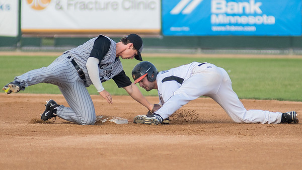 Daniel Amaral of the MoonDogs is tagged out by LaCrosse's Jake Hirabayashi after over sliding second base on a steal attempt in Thursday's Northwoods League game at Franklin Rogers Park. Photo by Jackson Forderer