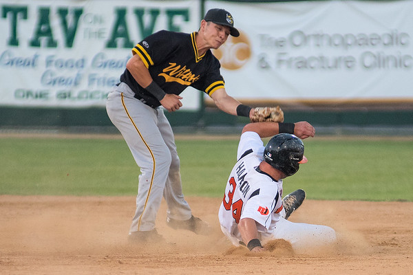 Toby Hanson of the Mankato MoonDogs slides safely into second base ahead of a tag by Willmar's Josh Bissonette during Friday's game at Franklin Rogers Park. Photo by Jackson Forderer