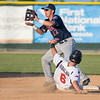 Alvara Rubalcaba (6) of the MoonDogs tries to break up a double play at second base as St. Cloud Rox's Angelo Altavilla (12) waits for the throw. Altavilla successfully completed the force at second and the double play. Photo by Jackson Forderer
