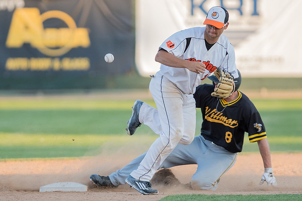 Kyle Cuellar of the MoonDogs loses the ball while trying to make a double play throw to first as Willmar's Caleb Ledbetter slides into second base. Photo by Jackson Forderer