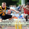 Mankato East's Matt Roberts (left) and Mankato West's Joey Booker run side by side during the boys 110 meter hurdles finals during the Section 2AA track meet Friday at Gustavus Adolphus College.