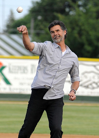 Former Minnesota Twins pitcher Rick Aguillera throws out the first pitch before the Mankato MoonDogs' home opener against St. Cloud Friday at Franklin Rogers Park.