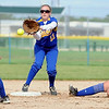 Le Sueur Henderson's Callie Boelter flips the ball to teammate Kelsey Schmidt to force a Maple River runner out at second base during the second inning Thursday at Caswell Park.