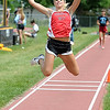 Mankato West's Rachel Gravley jumps during the girls triple jump at the Section 2AA track meet Friday in St. Peter.