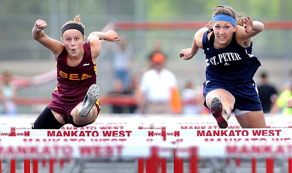 Blue Earth Area's Marissia Hagedorn and St. Peter's Kaitlin Kamm run side by side during the 100 meter hurdles final at the section 2A meet Saturday at Mankato West. While Hagedorn edged Kamm to win the event both will be going to the state track and field meet.
