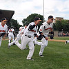 The Mankato MoonDogs take the field at the start of their home opener against St. Cloud Friday at Franklin Rogers Park.