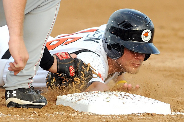 Mankato MoonDogs' Trey Nielsen is tagged out at first base during their home opener against St. Cloud Friday at Franklin Rogers Park.