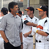 Mankato MoonDogs player Trey Nielsen talks with former Minnesota Twins pitcher Rick Aguillera before the team's home opener Friday at Franklin Rogers Park. Nielsen's father was a college teammate of Aguillera.