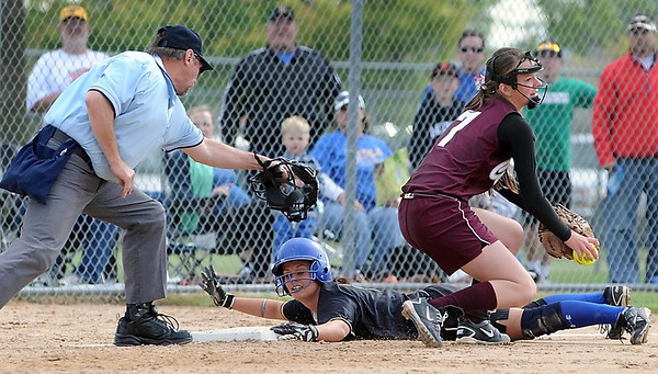Mankato Loyola's Maddie McCargar slides safely into third base ahead of the tag of New Ulm Cathedral's MacKinnon Ehlenz during their game Thursday at Caswell Park.