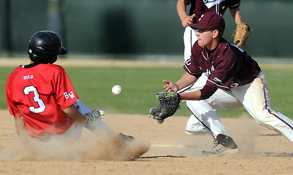 New Ulm Cathedral's Josh Kienlen fields the throw to second base as BOLD baserunner Zach Remillard tries to slide in under the tag during their first game Tuesday at Franklin Rogers Park.
