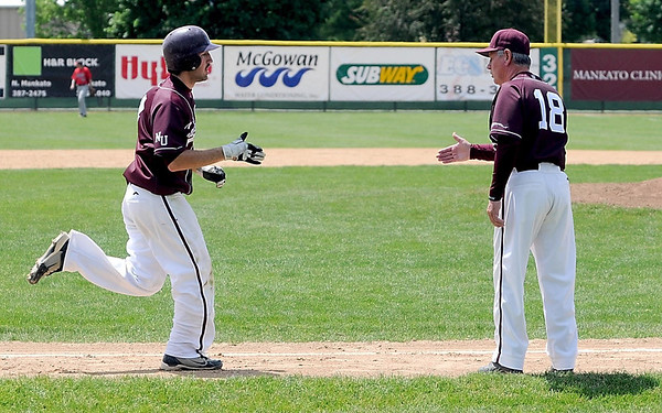 New Ulm Cathedral's Dan Blackstad is congradulated by coach Bob Weier after hitting a home run in the sixth inning of their Section 2A baseball tournament game against United South Central Saturday at Franklin Rogers Park.