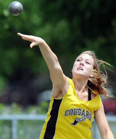 Mankato East's Whitney Carriveau competes in the finals of the girls shot put at Friday's Section 2AA meet Friday in St. Peter.