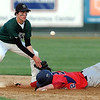 Waterville-Elysian-Morristown's Brady Hruska can't hang on to the throw as United South Central's Try Allis steals second base during their game Thursday at Franklin Rogers Park.