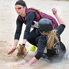 Pat Christman<br /> New Ulm Cathedral's Lisa Helget loses the ball as Blooming Prairie's Sydney Heiber slides into second base during their State Class A quarterfinal game Thursday at Caswell Park in North Mankato.