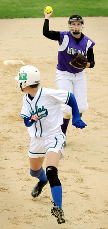New Ulm's Ellie Schneider chases Maple River's Emily Spear in a run-down between second and third base during quarterfinal Class AA action Thursday at Caswell Park.