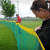 John Cross<br /> Mitch Sellers and Piper Timmerman erect an outfield fence at Caswell Park in preparation for the Minnesota State High School Softball Tournament that begins today in North Mankato.