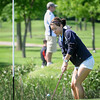 John Cross<br /> Minnesota Valley Lutheran golfer Chrissy Biedenbender chips onto a green during Section 2A golf at North Links on Monday.