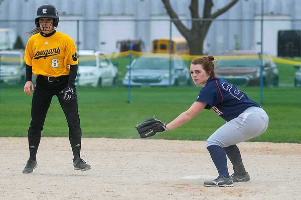 St. Peter's Olivia McCabe awaits a throw as she holds Mankato East's Madisyn Kozitza to second base in a game played on May 19. McCabe and the St. Peter softball team will begin play in the state tournament today. Photo by Jackson Forderer