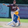 Mankato Loyola's Matthew Helget successfully breaks up a double play with a take out slide on New Ulm Cathedral's Will Schubert during Wednesday's Section 2A playoff game. Cathedral won the game 15-12. Photo by Jackson Forderer