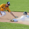 Mankato East's Jack Clifford is tagged out at second base by Hutchinson's Lane Glaser during a steal attempt in Saturday's Section 2AAA playoff game. East lost 2-1. Photo by Jackson Forderer
