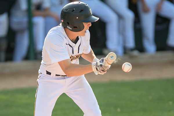 Mankato East's Grant Hermer lays down a bunt in a Section 2AAA playoff game against Hutchinson played in New Ulm on Saturday. Photo by Jackson Forderer