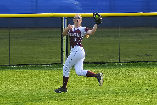 New Ulm Cathedral's Lauryn Franta makes an acrobatic catch in centerfield in a Section playoff game against Mountain Lake Area. Photo by Jackson Forderer