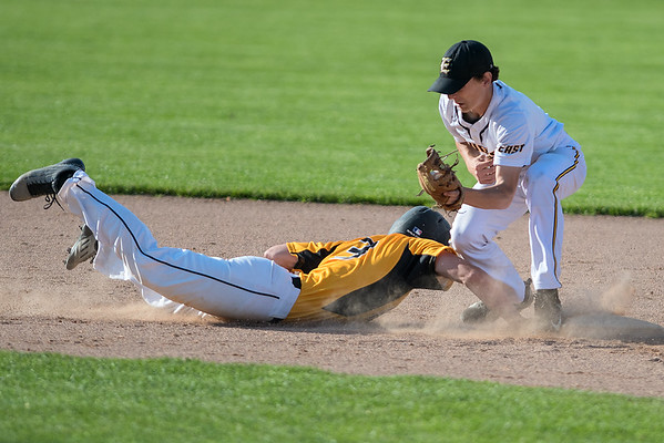 Mankato East's Grant Hermer tries to put a tag on Hutchinson's Tate Card during a pickoff attempt. Photo by Jackson Forderer
