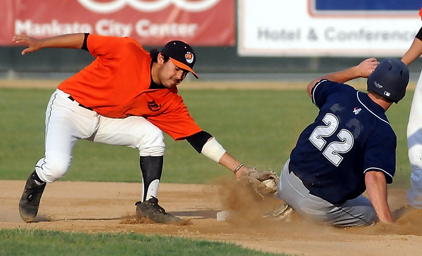 John Cross<br /> Duluth's Luke Campbell is tagged out by MoonDog Chris Munoz after being caught off first during a  piick-off play Tuesday at Franklin Rogers Park.